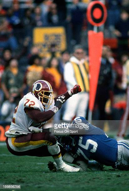 Dexter Manley of the Washington Redskins gets blocked by Lomas Brown of the Detroit Lions during an NFL football game November 15 1987 at RFK...