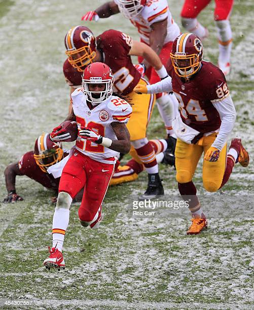 Dexter McCluster of the Kansas City Chiefs returns a punt for a second quarter touchdown in front of Niles Paul of the Washington Redskins at...