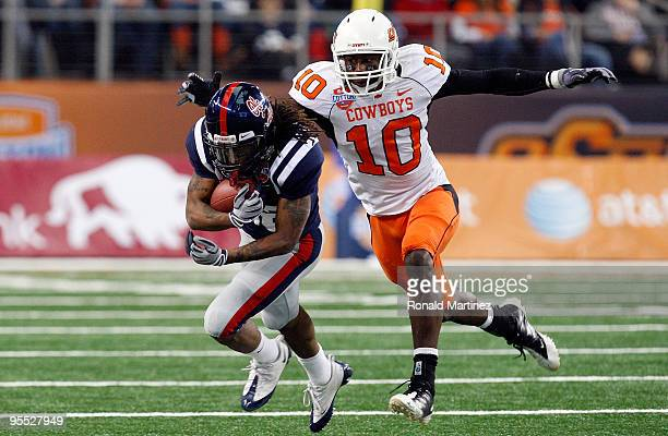 Dexter McCluster of the Mississippi Rebels runs the ball against Markelle Martin of the Oklahoma State Cowboys during the ATT Cotton Bowl on January...