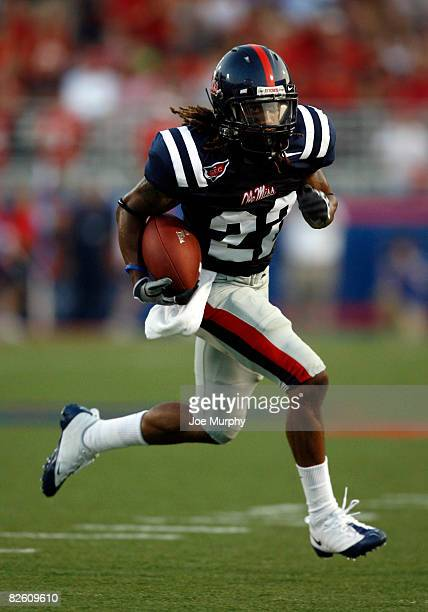 Dexter McCluster of the Mississippi Rebels runs with the ball during a game against the Memphis Tigers on August 30, 2008 at Vaught-Hemingway...