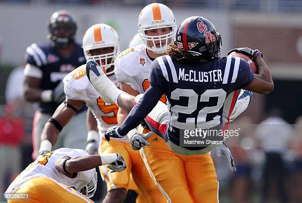 Dexter McCluster of the Ole Miss Rebels gets flipped during a run against the Tennessee Volunteers at VaughtHemingway Stadium on November 14 2009 in...