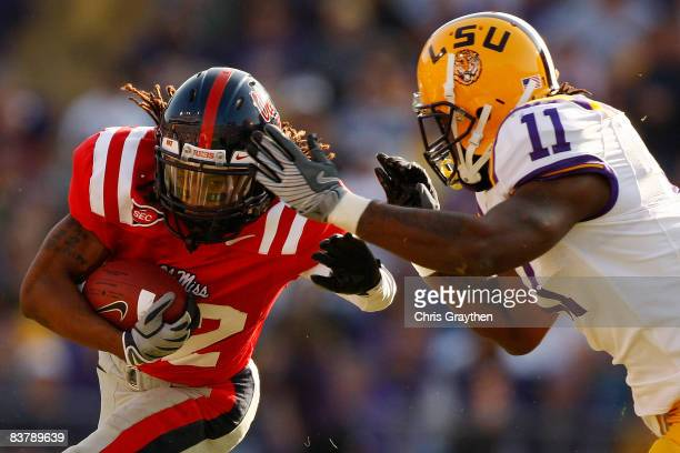 Dexter McCluster of the Ole Miss Rebels is tackled by Kelvin Sheppard of the Louisiana State University Tigers on November 22, 2008 at Tiger Stadium...