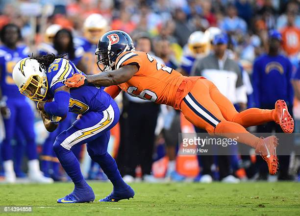 Dexter McCluster of the San Diego Chargers runs for a first down as he is tackled by Darian Stewart of the Denver Broncos during the second quarter...