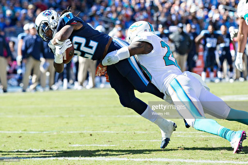 Dexter McCluster #22 of the Tennessee Titans dives to the goal line while being tackled by Reshad Jones #20 of the Miami Dolphins at LP Field on October 18, 2015 in Nashville, Tennessee. The Dolphins defeated the Titans 38-10.