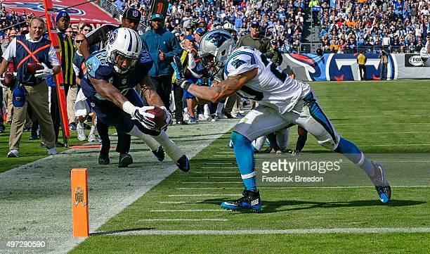 Dexter McCluster of the Tennessee Titans dives towards the pilon to score a touchdown against Kurt Coleman of the Carolina Panthers during the first...