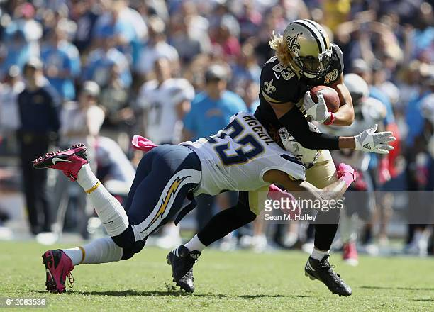 Dexter McCoil of the San Diego Chargers tackles Willie Snead of the New Orleans Saints during the first half at Qualcomm Stadium on October 2 2016 in...