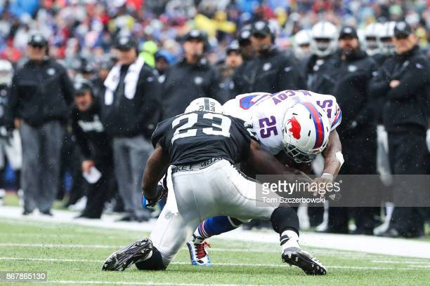 Dexter McDonald of the Oakland Raiders attempts to tackle LeSean McCoy of the Buffalo Bills during the second quarter of an NFL game on October 29...