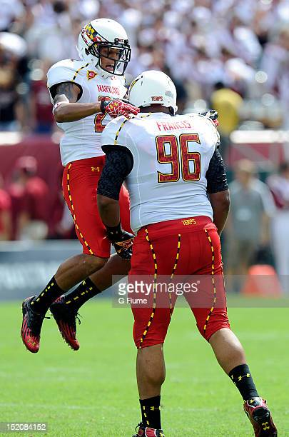 Dexter McDougle and AJ Francis of the Maryland Terrapins celebrate a defensive stop against the Temple Owls at Lincoln Financial Field on September 8...