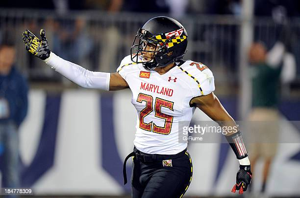 50f780eea0c Dexter McDougle of the Maryland Terrapins celebrates after returning an  interception for a touchdown against the