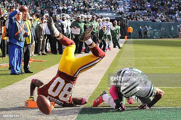 Dexter McDougle of the New York Jets breaks up a pass intended for Jamison Crowder of the Washington Redskins during the fourth quarter at MetLife...