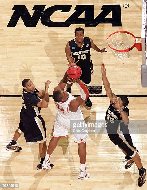 Dexter Pittman of the Texas Longhorns shoots the ball over Tony Woods of the Wake Forest Demon Deacons during the first round of the 2010 NCAA men�s...