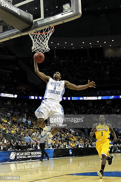 Dexter Strickland of the North Carolina Tar Heels dunks the ball against Darius JohnsonOdom of the Marquette Golden Eagles during the second half of...