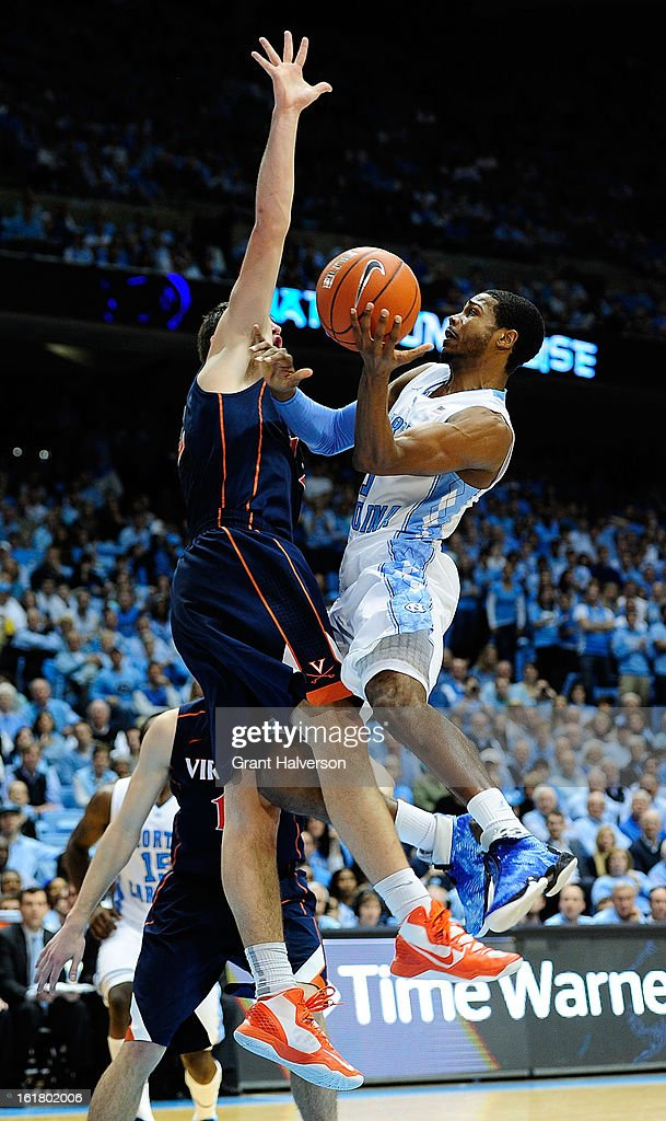 Dexter Strickland #1 of the North Carolina Tar Heels shoots against Joe Harris #12 of the Virginia Cavaliers during play at the Dean Smith Center on February 16, 2013 in Chapel Hill, North Carolina. North Carolina won 93-81.