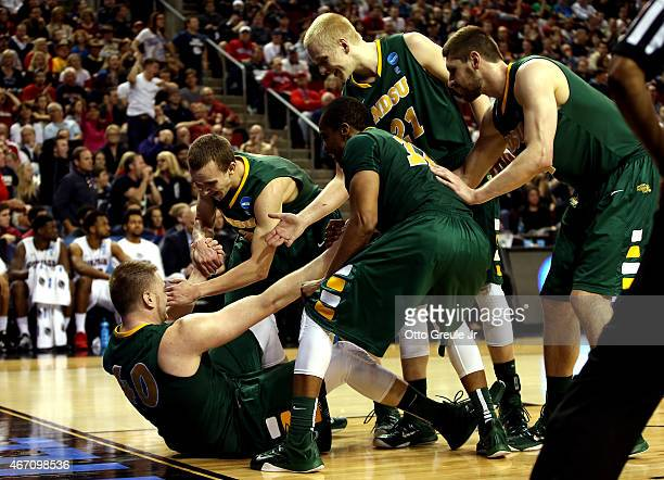 Dexter Werner of the North Dakota State Bison gets helped up by his teammates after points in the second half of the game against the Gonzaga...