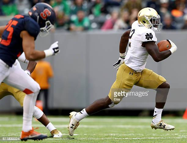Dexter Williams of the Notre Dame Fighting Irish breaks away and runs the ball in for a touchdown in the second half against the Syracuse Orange at...