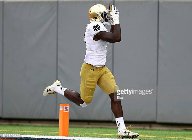 Dexter Williams of the Notre Dame Fighting Irish celebrates his touchdown in the second half against the Syracuse Orange at MetLife Stadium on...