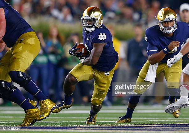 Dexter Williams of the Notre Dame Fighting Irish runs the ball against the Stanford Cardinal at Notre Dame Stadium on October 15 2016 in South Bend...