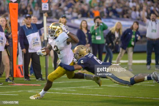 Dexter Williams of the Notre Dame Fighting Irish runs with the ball in the 1st half against Sean Wiiliams of the Navy Midshipmen at SDCCU Stadium on...