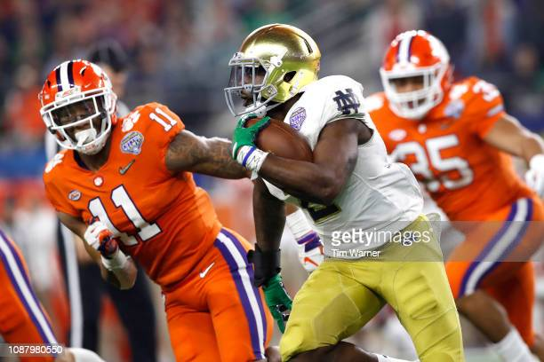 Dexter Williams of the Notre Dame Fighting Irish runs with the ball in the second half against Isaiah Simmons of the Clemson Tigers during the...
