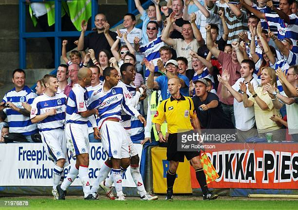 Dextor Blackstock of Queens Park Rangers celebrates with team mates and fans after scoring his sides second goal during the Coca-Cola Championship...