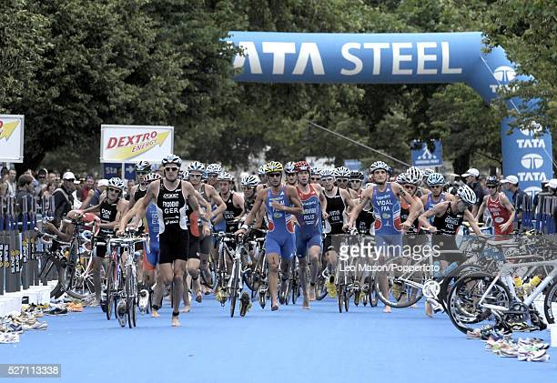 Dextro Energy/ ITU World Championship Triathlon Hyde Park London UK Competitors in the transition stage from cycling to running The event was won by...