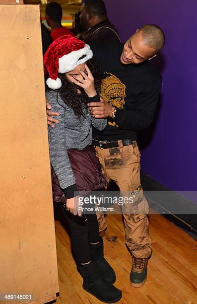 Deyjah Harris and TI attend a toy drive at Metroplex Atlanta on December 20 2013 in Atlanta Georgia