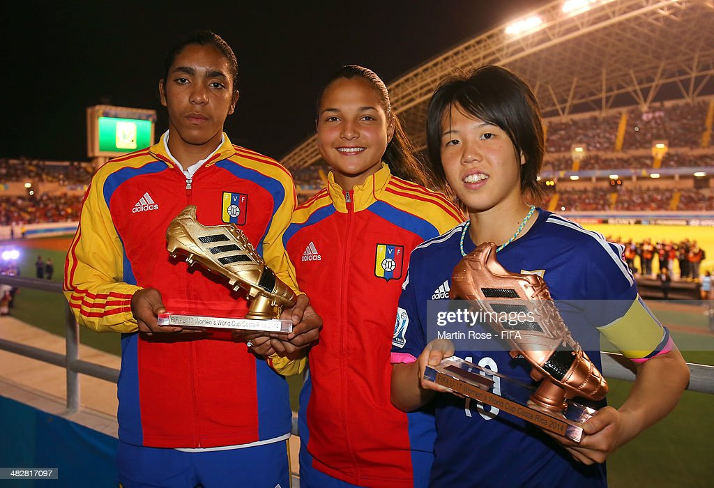 Deyna Castellanos (C) and Gabriela Garcia (L) of Venezuela pose with the adidas Golden Boot and Hina Sugita pose with the adidas Bronze Boot during the FIFA U-17 Women's World Cup 2014 final match between Japan and Spain at Estadio Nacional on April 4, 2014 in San Jose, Costa Rica.