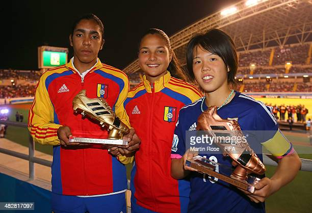Deyna Castellanos and Gabriela Garcia of Venezuela pose with the adidas Golden Boot and Hina Sugita pose with the adidas Bronze Boot during the FIFA...