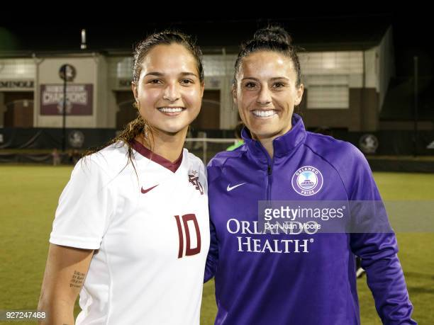 Deyna Castellanos of the Florida State Seminoles pose with Ali Krieger of the Orlando Pride after a preseason match at the Seminole Soccer Complex on...