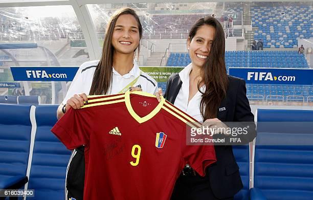 Deyna Castellanos of Venezuela hands a signed jersey for the FIFA museum over to FIFA representative Lorena Magali Soto Giubi prior to the FIFA U17...