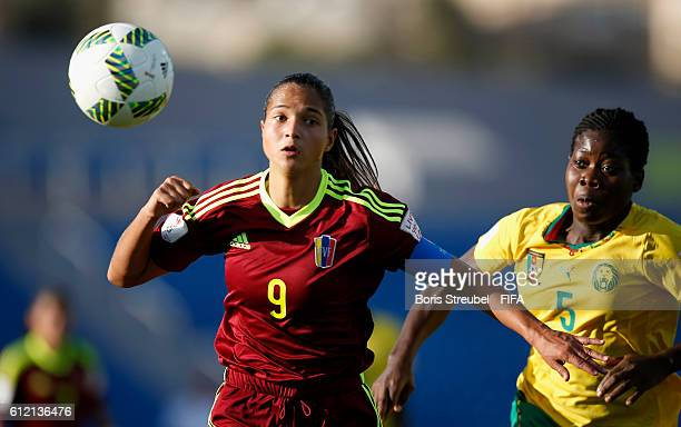Deyna Castellanos of Venezuela is challenged by Eni Kuchambi of Cameroon during the FIFA U17 Women's World Cup Group B match between Venezuela and...