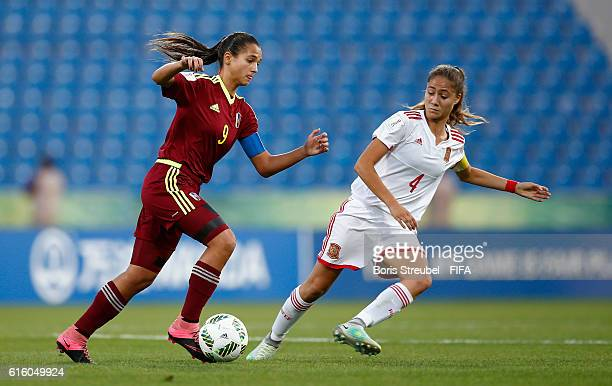 Deyna Castellanos of Venezuela is challenged by Laia Aleixandri of Spain during the FIFA U17 Women's World Cup Third Place Play Off match between...
