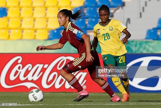 Deyna Castellanos of Venezuela is challenged by Michele Moumazim of Cameroon during the FIFA U17 Women's World Cup Group B match between Venezuela...