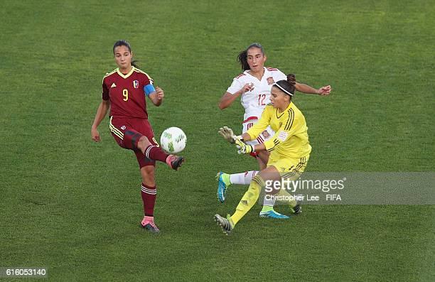 Deyna Castellanos of Venezuela tries to chip Noelia Ramos of Spain during the FIFA U17 Women's World Cup Jordan 2016 Third Place PlayOff match...