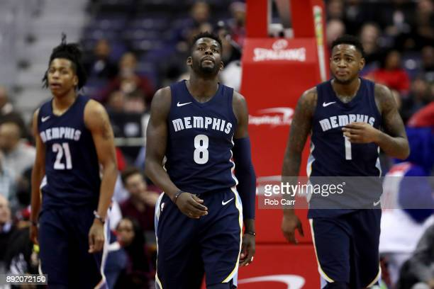 Deyonta Davis James Ennis III and Jarell Martin of the Memphis Grizzlies walk off the court during a timeout against the Washington Wizards at...
