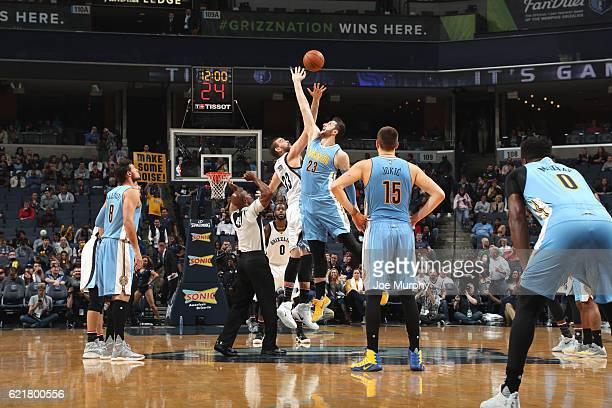 Deyonta Davis of the Memphis Grizzlies and Jusuf Nurkic of the Denver Nuggets jump for the ball on November 8 2016 at FedExForum in Memphis Tennessee...