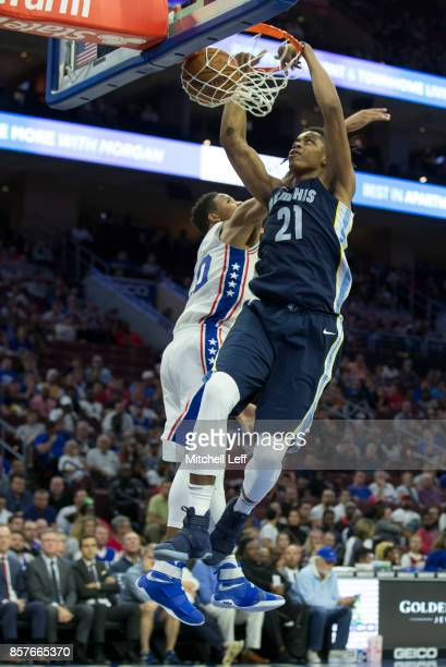 Deyonta Davis of the Memphis Grizzlies dunks the ball against Markelle Fultz of the Philadelphia 76ers in the third quarter of the preseason game at...