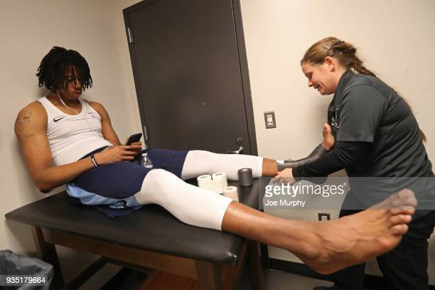 Deyonta Davis of the Memphis Grizzlies gets treatment before the game against the Brooklyn Nets on March 19 2018 at Barclays Center in Brooklyn New...