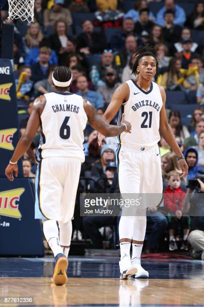 Deyonta Davis of the Memphis Grizzlies gives high five to teammate Mario Chalmers of the Memphis Grizzlies during the game against the Dallas...