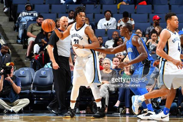 Deyonta Davis of the Memphis Grizzlies handles the ball against Bismack Biyombo of the Orlando Magic during a preseason game on October 2 2017 at...