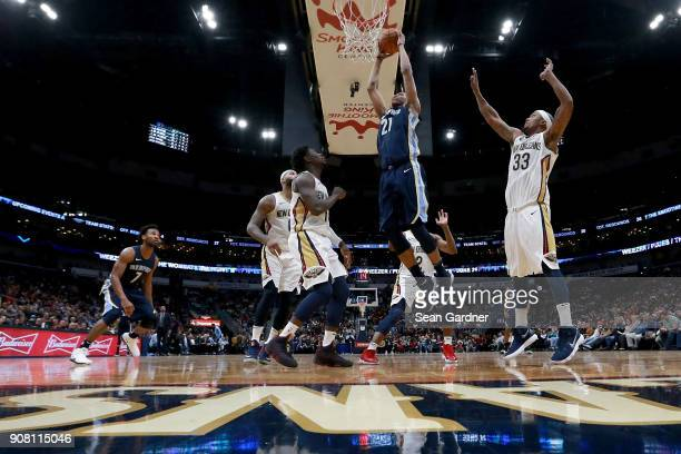 Deyonta Davis of the Memphis Grizzlies shoots over Dante Cunningham of the New Orleans Pelicans during the second half of a NBA game at the Smoothie...