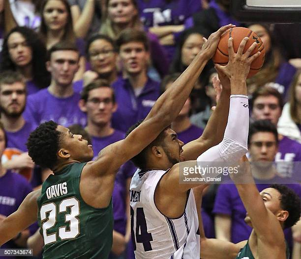 Deyonta Davis of the Michigan State Spartans blocks a shot by Sanjay Lumpkin of the Northwestern Wildcats at WelshRyan Arena on January 28 2016 in...