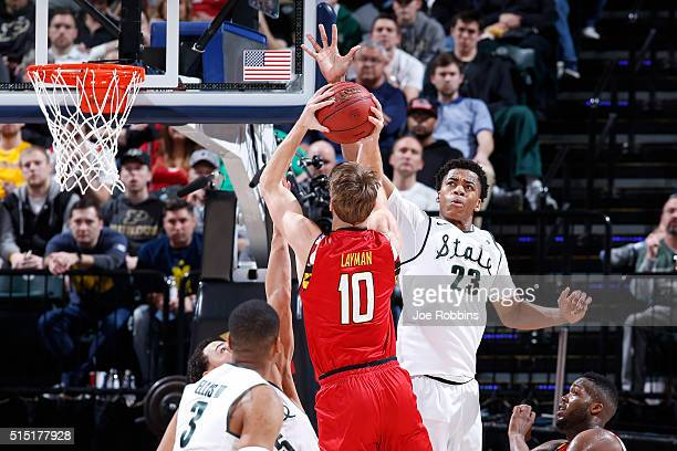 Deyonta Davis of the Michigan State Spartans defends against Jake Layman of the Maryland Terrapins in the semifinals of the Big Ten Basketball...