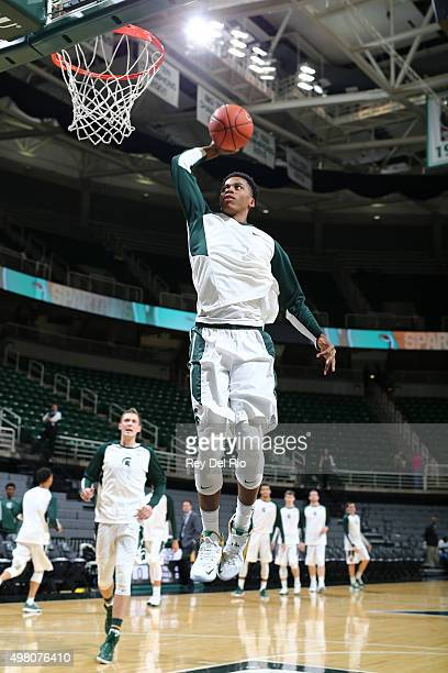 Deyonta Davis of the Michigan State Spartans dunks the ball during warmups prior to the game against the ArkansasPine Bluff Golden Lions at the...