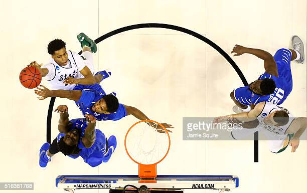 Deyonta Davis of the Michigan State Spartans goes up with the ball against Darnell Harris and Perrin Buford of the Middle Tennessee Blue Raiders in...