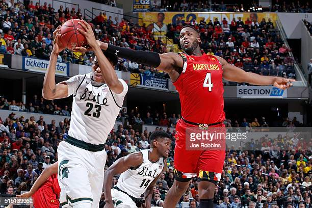 Deyonta Davis of the Michigan State Spartans rebounds against Robert Carter of the Maryland Terrapins in the semifinals of the Big Ten Basketball...