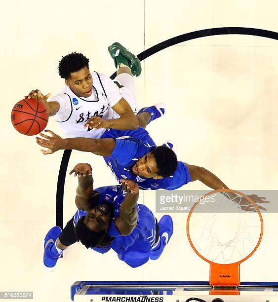 Deyonta Davis of the Michigan State Spartans shoots as Perrin Buford and Darnell Harris of the Middle Tennessee Blue Raiders defend during the first...