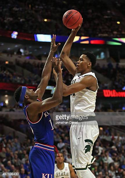 Deyonta Davis of the Michigan State Spartans shoots over Carlton Bragg Jr #15 of the Kansas Jayhawks during the Champions Classic at the United...