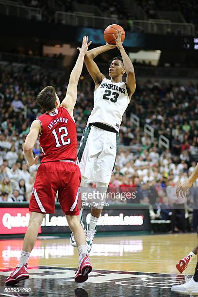 Deyonta Davis of the Michigan State Spartans shoots over Michael Jacobson of the Nebraska Cornhuskers late in the second half at the Breslin Center...