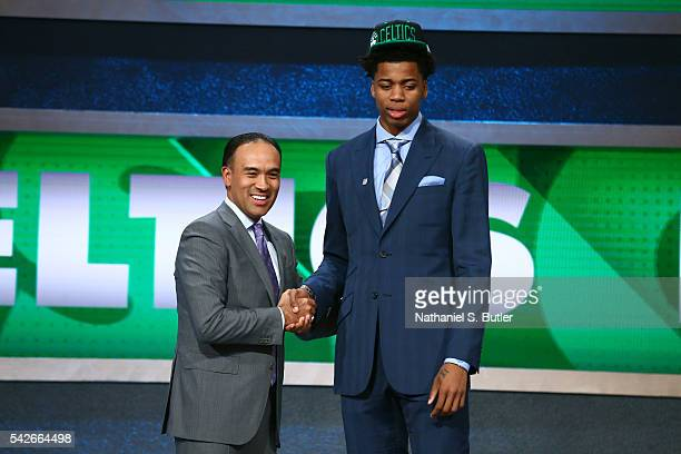 Deyonta Davis shakes hands with NBA Deputy Commissioner and Chief Operating Officer Mark Tatum after being selected number thirty first overall by...